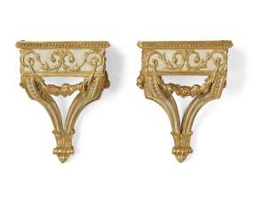 A PAIR OF FRENCH WHITE-PAINTED AND PARCEL-GILT WALL BRACKETS