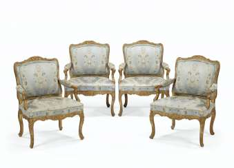 A SET OF FOUR EARLY LOUIS XV GILTWOOD FAUTEUILS