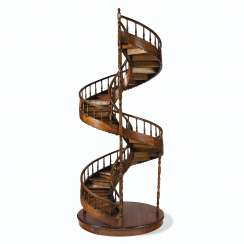 A CONTINENTAL WALNUT MODEL OF A SPIRAL STAIRCASE