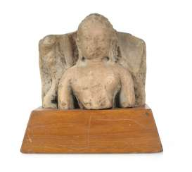 Stone sculpture of Buddha on a wooden base