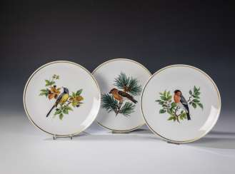 Three wall plates with bird painting