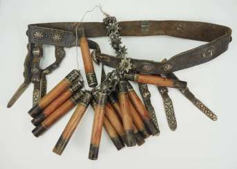 Caucasian: belts and cartridges. Leather belt with metal fittings