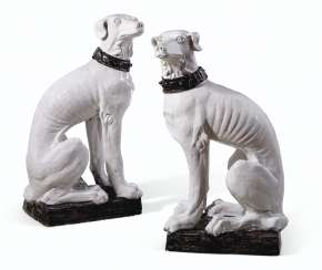 A VERY LARGE PAIR OF ITALIAN FAIENCE MODELS OF DOGS