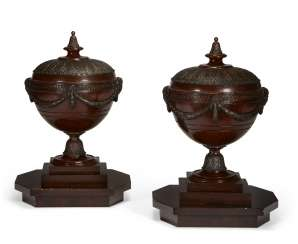 A PAIR OF GEORGE III STYLE MAHOGANY URNS AND COVERS