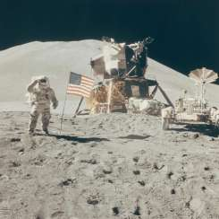 Saluting the flag: Astronaut David Scott performs military salute beside American flag, lunar module