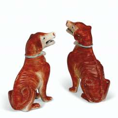 A PAIR OF IRON-RED HOUNDS