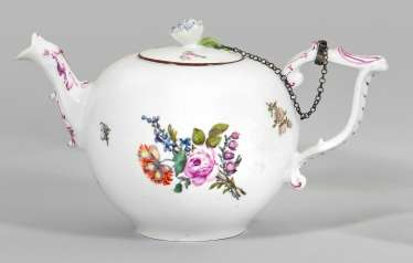 Small teapot with floral decor