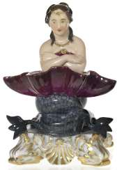 A Porcelain Figurine of a Naiad with a Seashell