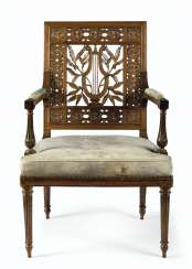 A LATE LOUIS XVI SOLID MAHOGANY FAUTEUIL