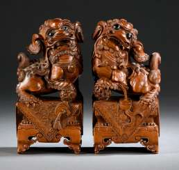 Finely carved with a Buddhist lion, a couple of boxwood