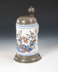 Faience-roll pitcher with bird and flowers
