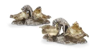 A PAIR OF SWEDISH PARCEL-GILT SILVER FIGURAL SALT CELLARS