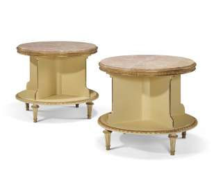 A PAIR OF CIRCULAR CREAM PAINTED AND PARCEL GILT SIDE TABLES...