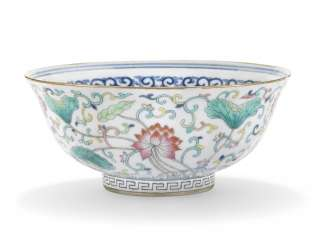 A CHINESE FAMILLE ROSE AND BLUE AND WHITE BOWL