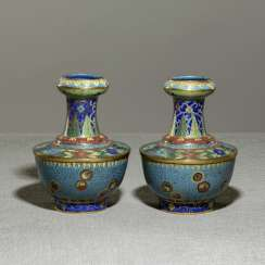 Pair of Cloisonné vases with flower decoration, partially fire gilded