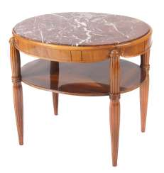 Oval Art Deco table with storage around 1930