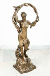 Large bronze sculpture of a gril with birds and scarf on naturalistic base