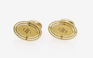 A Pair of cufflinks with engraved