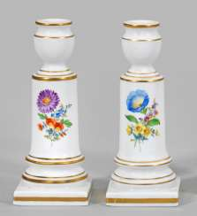 Pair of candlesticks with floral decoration