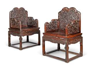 A PAIR OF CHINESE STAINED-PADAUK ARMCHAIRS