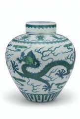 A GREEN-ENAMELED AND UNDERGLAZE BLUE 'DRAGON' JAR AND COVER