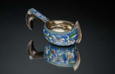 A bucket of silver with enamel.