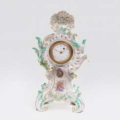 Small rococo clock with a deer head