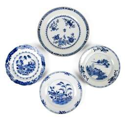 Four Export porcelain plates with blue-and-white decor