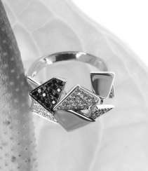 Geometric cocktail ring with black and white diamonds