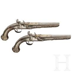 A pair of silver-mounted luxury flintlock pistols, Ottoman, around 1820