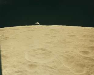 Crescent Earth emerging over the lunar horizon; crescent Earthrise, seen from the lunar module during the descent to the lunar surface, January 31-February 9, 1971