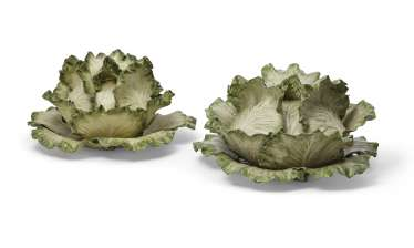 TWO VLADIMIR KANEVSKY CERAMIC CABBAGE TUREENS, COVERS AND STANDS