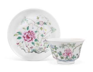 A CHINESE FAMILLE ROSE CUP AND SAUCER