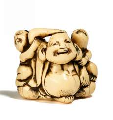 Netsuke: Seated Hotei with two Karako
