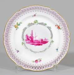 Ornamental plates with landscape decoration