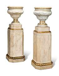 A PAIR OF GREY-VEINED WHITE MARBLE URNS