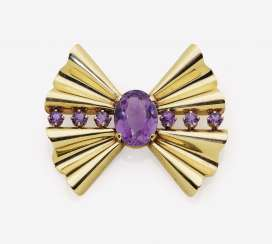 Stylized loops brooch with amethysts