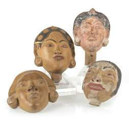 Four wood carvings in the Form of masks