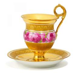 Cup and saucer with rose ribbon decor