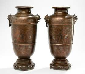 Pair of vases in Bronze with figural scenes and handle in the shape of Oni heads