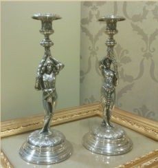 Candlesticks in the form of male and female figures