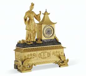 A LOUIS PHILIPPE ORMOLU AND PATINATED-BRONZE MANTEL CLOCK