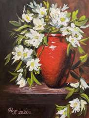 """White flowers in a red vase""."