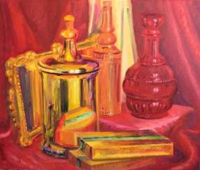 Golden vessel and red decanter.