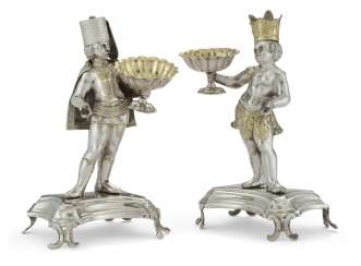 A PAIR OF CONTINENTAL PARCEL-GILT SILVER FIGURAL SALT CELLARS