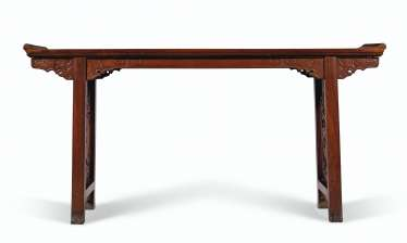A RARE HUANGHUALI TRESTLE-LEG TABLE