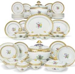 A LARGE FAMILLE ROSE AND GILT DINNER SERVICE