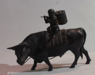 Boy on water Buffalo 19th century.