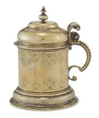 A GERMAN SILVER-GILT MINIATURE TANKARD
