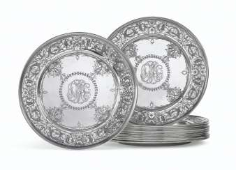 A SET OF TWELVE AMERICAN SILVER PLACE PLATES